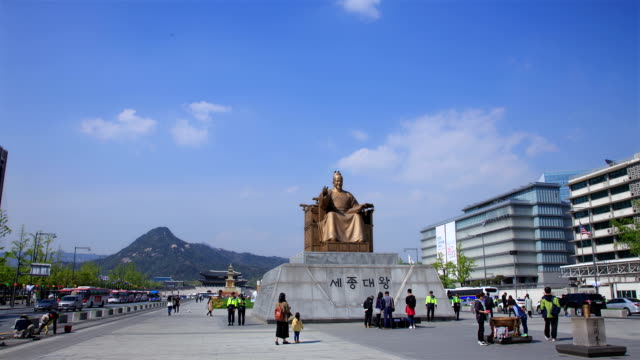 bronze statue of sejongdaewang (the 15th century korean monarch and the inventor of hangul) at gwanghwamun square - male likeness stock videos & royalty-free footage