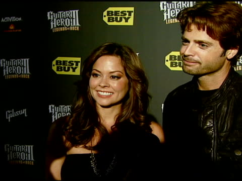 brooke burke and david charvet on the event playing the game and guitar legends at the best buy presents guitar hero® iii legends of rock launch... - brooke burke stock videos and b-roll footage