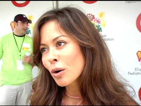 brooke burke on the amount of time she's been involved on the money that is raised by the event and on her upcoming rock and roll show with dave... - アタイムフォーヒーローズ点の映像素材/bロール