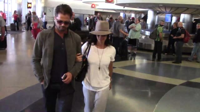 brooke burkecharvet and david charvet arriving at lax airport at celebrity sightings in los angeles on september 14 2015 in los angeles california - brooke burke stock videos and b-roll footage
