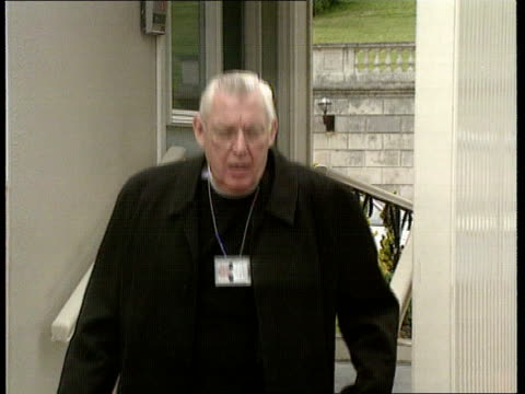 Brooke initiative talks chairman UNKNOWN MS Rev Ian Paisley out of building and down steps towards LMS Gerry Collins getting into car MS SIDE Paisley...