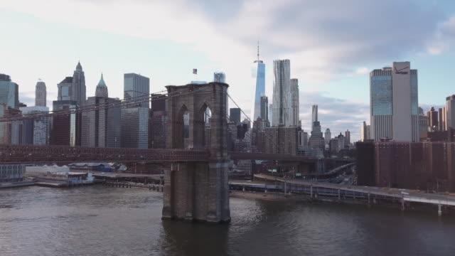 brooklyn bridge aerial view sunset - brooklyn bridge stock videos & royalty-free footage