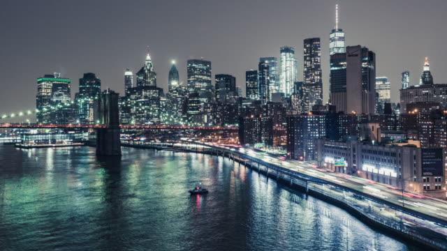 T/L WS HA TU Brooklyn Bridge and Manhattan skyline at Night / New York, USA