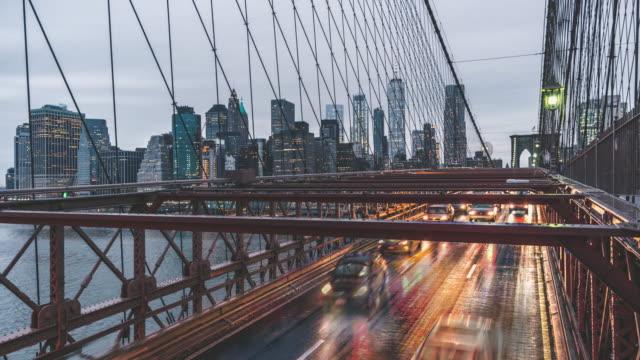 t/l zi brooklyn bridge and manhattan skyline, day to night transition / new york, usa - international landmark stock videos & royalty-free footage