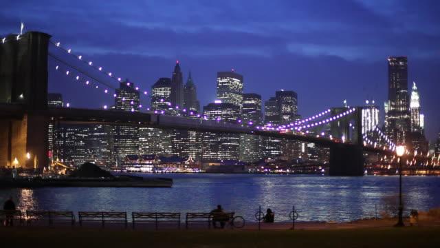 ws brooklyn bridge and manhattan skyline illuminated at night / new york city, new york, usa - brooklyn bridge stock videos & royalty-free footage