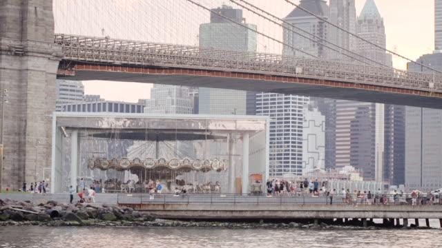 brooklyn bridge and new york city skyline - establishing shot - sunset - summer 2016 - waterfront stock videos & royalty-free footage