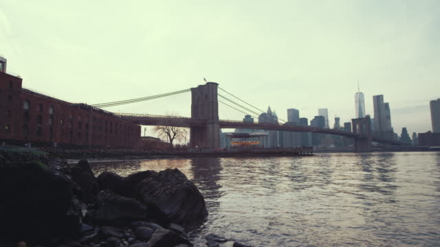 Brooklyn bridge and river on a dreary day