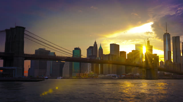 brooklyn bridge, freedom tower, and sun rays - twilight stock videos & royalty-free footage