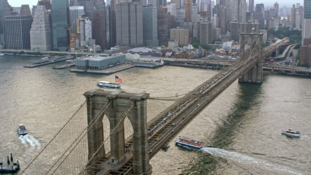 aerial brooklyn bridge over east river - brooklyn bridge stock videos & royalty-free footage