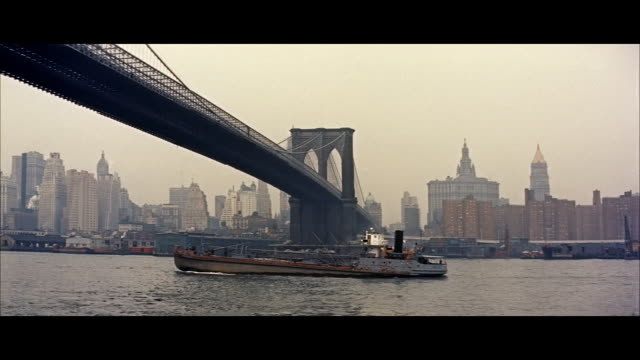 WS Brooklyn Bridge over River East with  skylines in background / New York City, New York State, United States