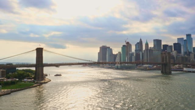 brooklyn bridge over the east river in new york - river east stock videos & royalty-free footage