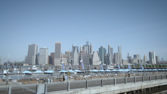 brooklyn bridge park promenade with very few people practicing social distancing and/or wearing masks on a warm spring day. this area is usually... - promenade stock videos & royalty-free footage