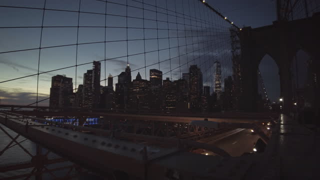 brooklyn bridge scene with manhattan skyline featuring one world trade center and other skyscrapers in new york city, new york on december 30, 2020.... - yellow taxi stock videos & royalty-free footage