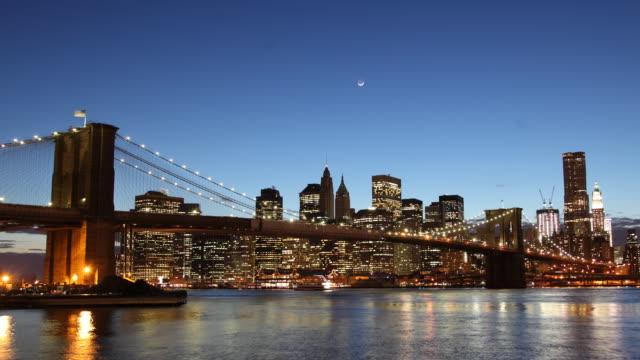 T/L WS Brooklyn Bridge with skyline at dusk / Manhattan, New York, USA