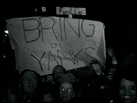 brooklyn dodgers fans hold up sign bring on the yanks brooklyn dodgers fans hold up sign on october 01 1949 in new york new york - ebbets field video stock e b–roll