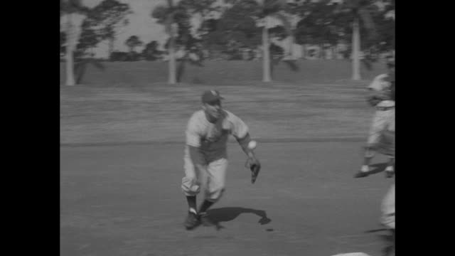 brooklyn dodgers players do jumping jacks on practice field during spring training in vero beach fl / they do stretching exercises / cu team captain... - spring training stock videos & royalty-free footage