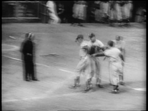 brooklyn dodgers players greeting carl furillo as he crosses home plate / world series - 1953 stock videos and b-roll footage