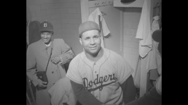 brooklyn dodgers players walking into locker room after defeating the milwaukee braves at county stadium in milwaukee to win the national league... - atlanta braves stock-videos und b-roll-filmmaterial