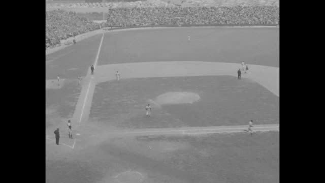 WS Brooklyn Dodgers playing Milwaukee Braves at County Stadium in Milwaukee / various shots crowd in stands watching game / WS Dodgers infielder Jim...