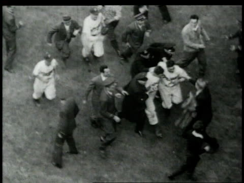 brooklyn dodgers running off field after winning the world series, fans pursuing and police protecting them / united states - 1949 stock videos & royalty-free footage