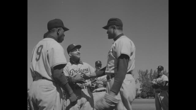Brooklyn Dodgers running toward camera at spring training in Vero Beach Florida / various shots manager Walter Alston talks to players while on one...