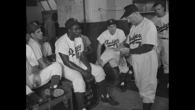 vs brooklyn dodgers team members including pee wee reese and jackie robinson listen to manager chuck dressen during team meeting at their stadium... - ebbets field video stock e b–roll