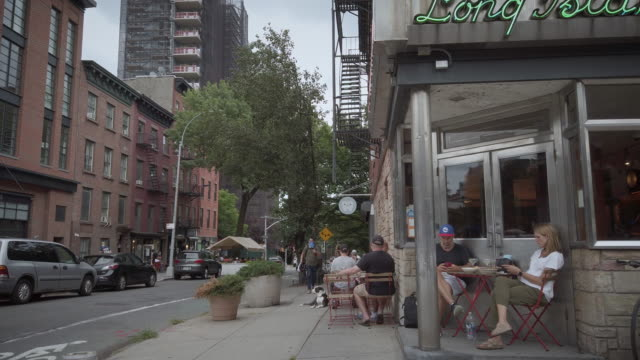 brooklyn new york / usa outdoor dining and drinking in brooklyn during coronavirus reopening restaurants and bars were allowed to serve customers on... - bar drink establishment stock videos & royalty-free footage