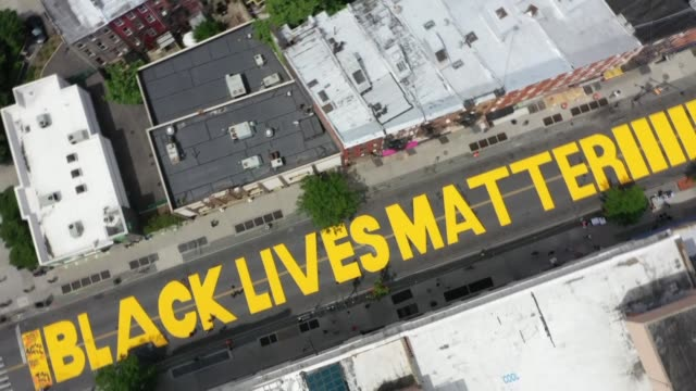 brooklyn transformed a major street into a black lives matter street mural. an amazing bird's eye view captured by anadolu agency on june 15 in new... - painting stock videos & royalty-free footage