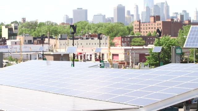 brooklyns flagship whole foods market in greenpoint new york on may 15 wide shot of solar panels set up outside of the whole foods market wide shot... - greenpoint brooklyn stock videos & royalty-free footage