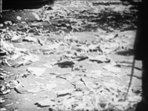 b/w 1929 broom sweeping up papercovered floor of stock exchange after heavy trading / newsreel - 1929 stock videos & royalty-free footage