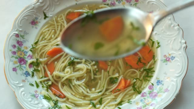 broth in a porcelain plate - broth stock videos & royalty-free footage