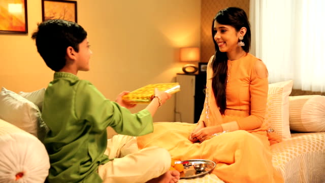 Brother and sister celebrating Raksha Bandhan, Delhi, India