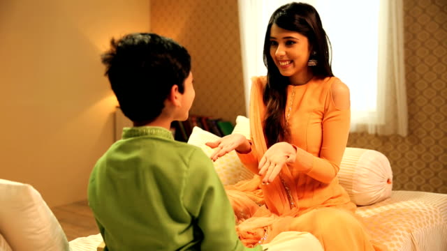 brother and sister celebrating raksha bandhan, delhi, india - brother stock videos & royalty-free footage