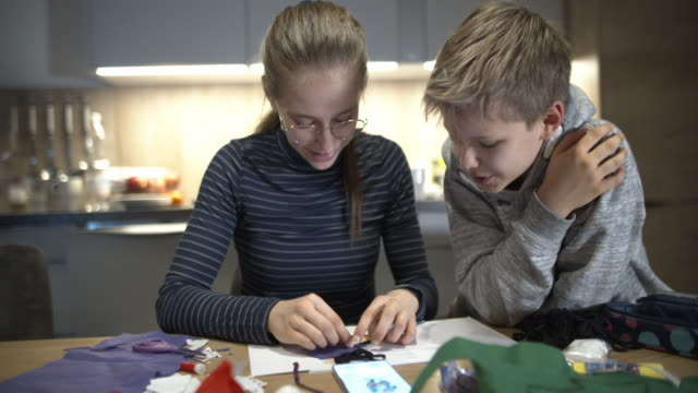 brother and sister crafting homework for art class - brother stock videos & royalty-free footage
