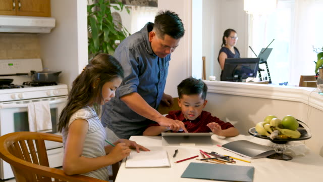 brother and sister doing school work at the kitchen table - filipino ethnicity stock videos & royalty-free footage