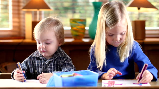 ms brother (12-23 months) and sister (4-5) drawing sitting at table / brussels, brabant, belgium - 12 23 months stock videos & royalty-free footage