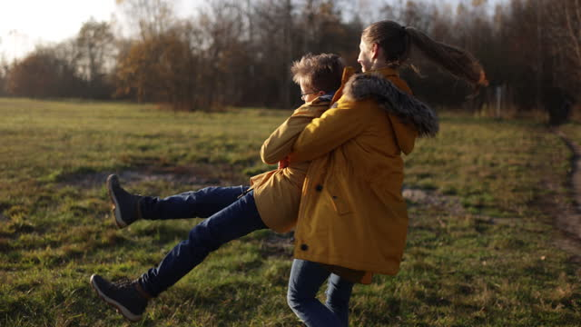 brother and sister enjoying autumn - warm clothing stock videos & royalty-free footage