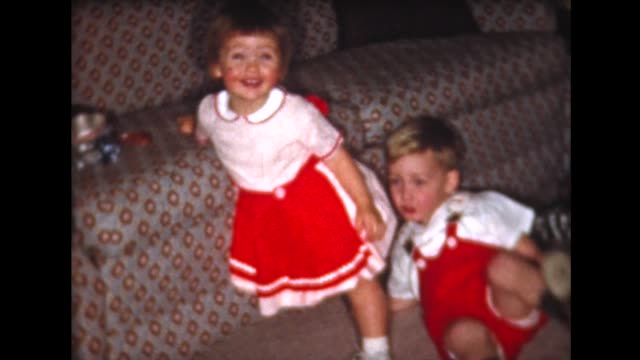 1961 brother and sister excited about Christmas presents