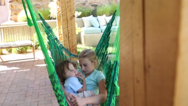 brother and sister in hammock