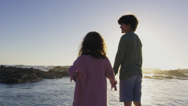 brother and sister joining parents - walking in water stock videos & royalty-free footage