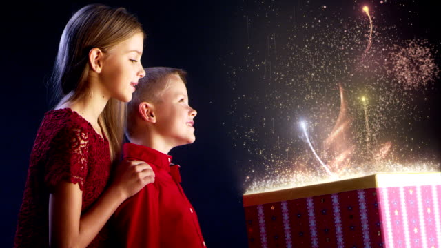 brother and sister opening magical christmas gift - sister stock videos & royalty-free footage
