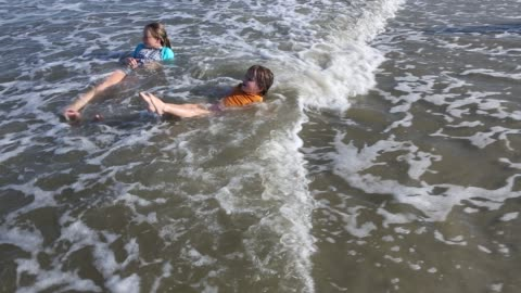 brother and sister playing at the beach - brother stock videos & royalty-free footage