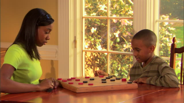 brother and sister playing checkers - draughts stock videos & royalty-free footage
