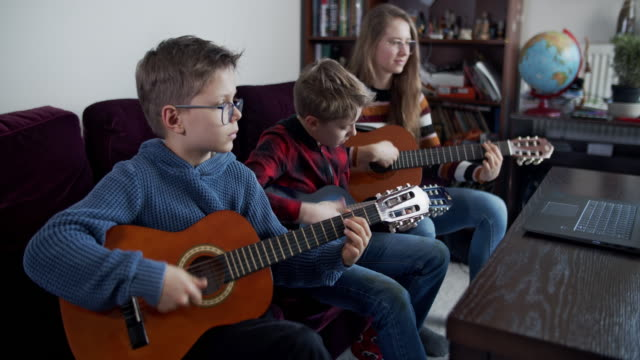 brother and sister playing guitars together - poland stock videos & royalty-free footage