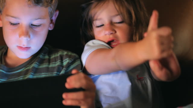 brother and sister playing handheld video game player - handheld video game stock videos & royalty-free footage