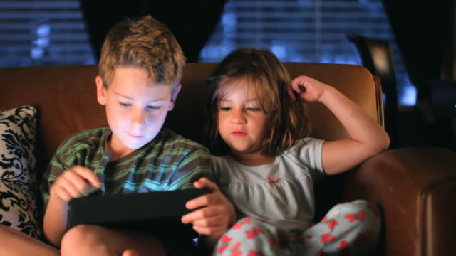 brother and sister playing handheld video game - handheld video game stock videos & royalty-free footage