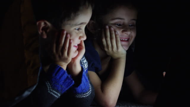 brother and sister watching a movie - television show stock videos & royalty-free footage
