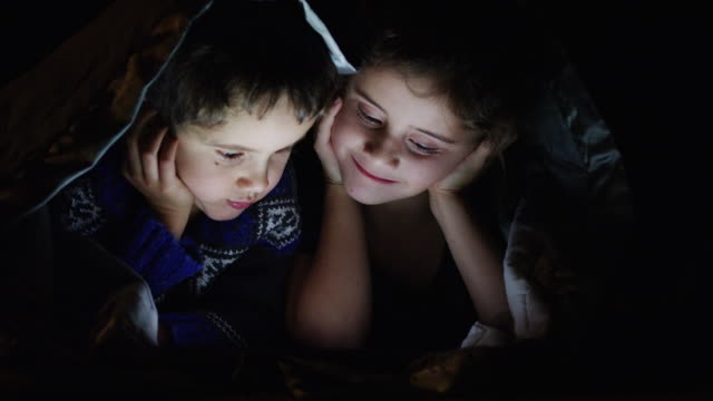 brother and sister watching a movie - duvet stock videos & royalty-free footage