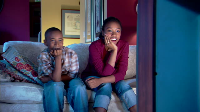 brother and sister watching television - three quarter length stock videos & royalty-free footage
