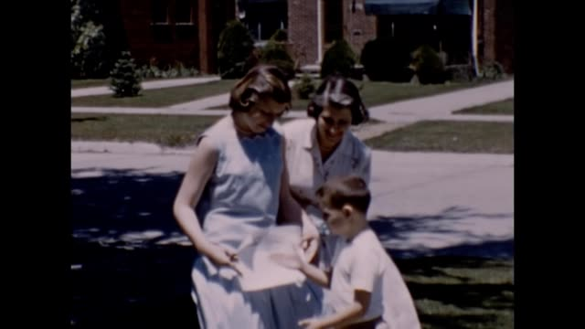 1957 Brother and Sister With Parents After Graduation